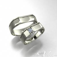 8. Witgouden trouwringen met diamant 0.08ct.  Paar 1420,-