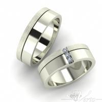 18. Witgouden trouwringen met diamant. Paar 1395.-