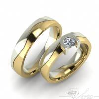 27.Bicolor trouwringen met diamant. Paar 1025.-