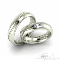 28. Witgouden trouwringen met diamant. Paar 920.-