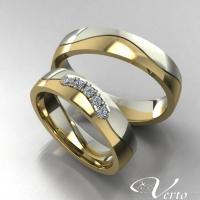 30.Bicolor trouwringen met diamant. Paar 1095.-